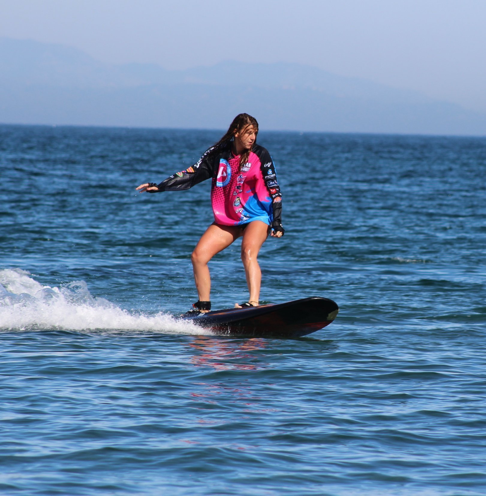 Girl riding onean carver x jetboard
